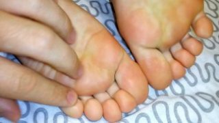 Sexy feet pose beautiful fingers and soles